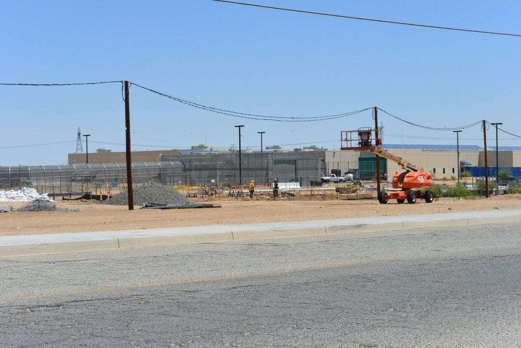 Photo/CIVIC: Construction workers working on the expansion of the Adelanto Detention  last year.