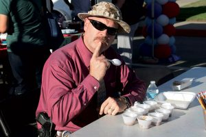 courtesy photo/rialto network Rialto police Captain Andy Karol ponders on which chili to vote for during last year's Chili Cook Off.