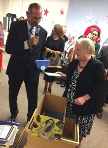 iecn photo/ yazmin alvarez Brian Montez, RUSD grounds supervisor and historian, gets a helping hand from school board president, Nancy O'Kelley, as he unveils items from a 25-year time capsule during the district's 125th anniversary celebration Sept. 21.
