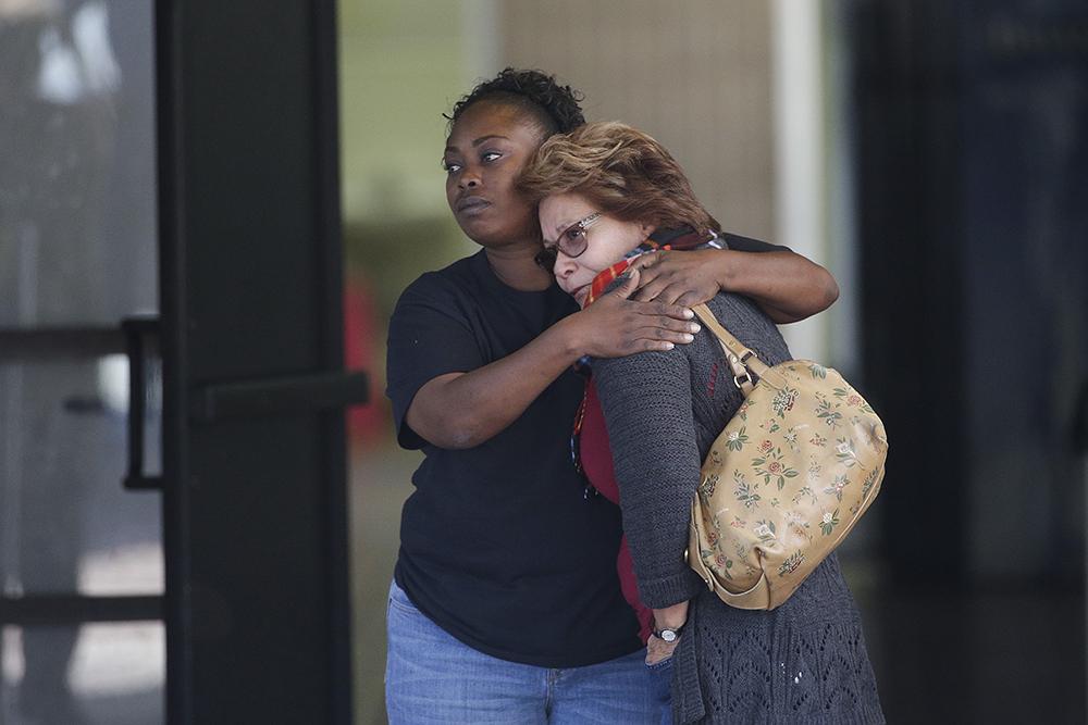 Photo/Associated Press: San Bernardino Parks and Recreation employee Juanita Webster embraces Councilwoman Virginia Marquez outside the Rudy Hernandez Center on December 2, 2015.