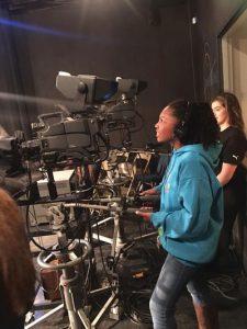 Girl-Reporter-Behind-Camera