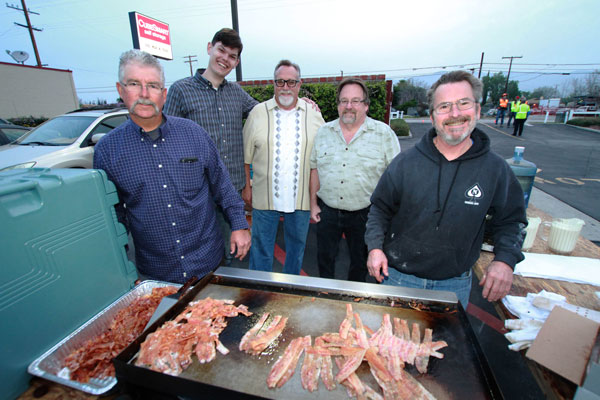 Photo/Ricardo Tomboc: Members of the Men's Ministry arrived extra early to cook pancakes and bacon for breakfast.  From left-to-right: Dan Smith, Landen Bigham, Pastor John Deming, Shawn Dill, and Dave Liskey.
