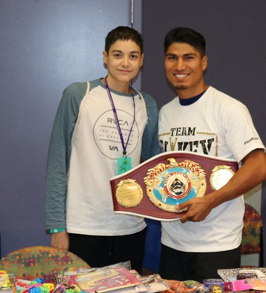 Photo LLUCH/Kelly Phipps Mikey Garcia poses with boxing fan Gilbert at Loma Linda University Children's Hospital. Garcia is holding his Super Featherweight title belt.