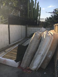 Photo/Anthony Victoria: A dumpster site at the Wood Ridge Villas filled with mattresses.