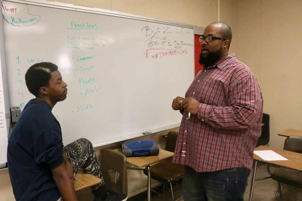 Photo/Anthony Victoria: CHORDS Edwin Johnson discussing an upcoming Kwanzaa Hip Hop performance with San Bernardino High School student Joseph Reed, 16, on November 28.